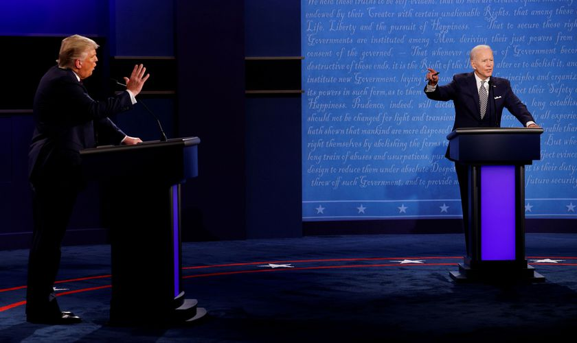 FILE PHOTO: U.S. President Donald Trump and Democratic presidential nominee Joe Biden participate in their first 2020 presidential campaign debate held on the campus of the Cleveland Clinic at Case Western Reserve University in Cleveland, Ohio, U.S., September 29, 2020. REUTERS/Brian Snyder/File Photo