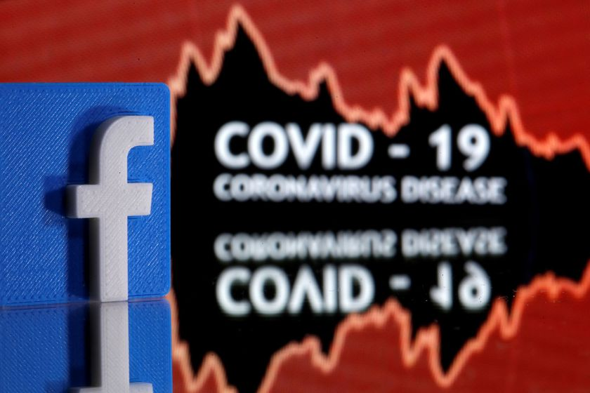 A 3D printed Facebook logo is seen in front of displayed coronavirus disease (COVID-19) words in this illustration