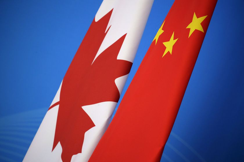 In this Nov. 12, 2018, file photo, flags of Canada and China are placed for the first China-Canada economic and financial strategy dialogue in Beijing, China. China says it has lodged a formal complaint with Canada over T-shirts ordered by one of the country's Beijing Embassy staff that allegedly mocked China's response to the coronavirus outbreak. (Jason Lee/Pool Photo via AP, File)