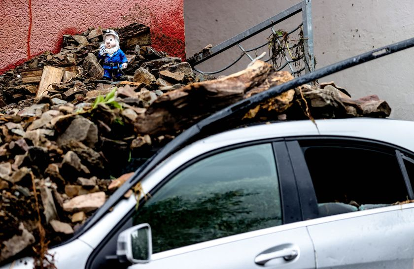 A figure placed on debris after flooding in Hagen