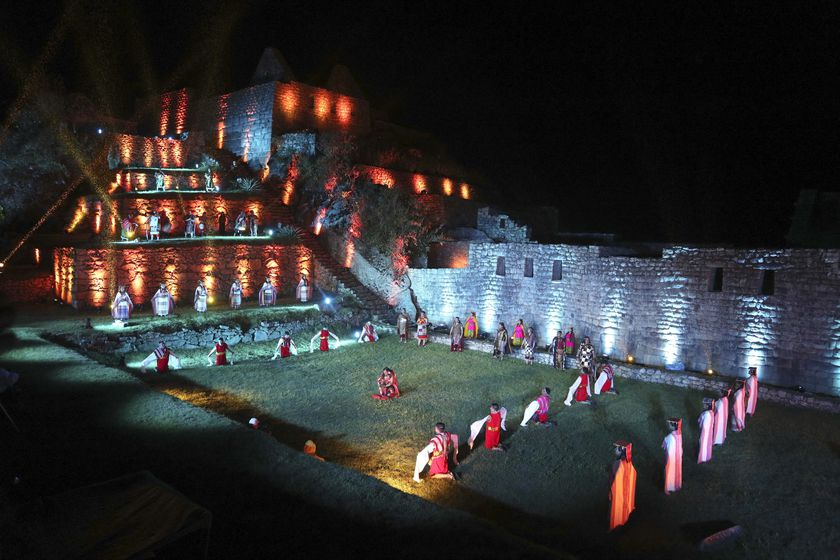 Artist Perform during a ceremony for the world-renowned Incan citadel of Machu Picchu as it reopens for the first time since its 8-months-long closure to help curb the spread of COVID-19, in the department of Cusco, Peru, Sunday, Nov. 1, 2020. (AP Photo/Martin Mejia)