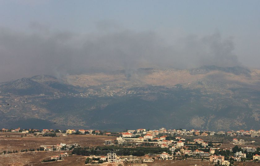Smoke rises from the disputed Shebaa Farms area as seen from Marjayoun village