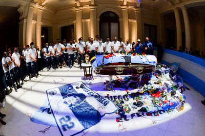 26 November 2020, Argentina, Buenos Aires: Players of the football club Gimnasia y Esgrima, which was managed by Diego Maradona, bid farewell to the late football star in the government palace. Photo: Presidencia argentina/telam/dpa