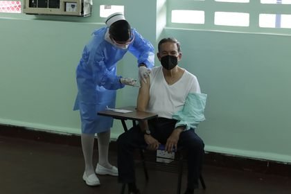 Panama's President Laurentino Cortizo is injected with a dose of the Pfizer COVID-19 vaccine during a mass vaccination campaign for people over age 60, in Panama City, Tuesday, March 9, 2021.  (AP Photo/Arnulfo Franco)
