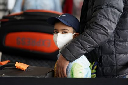 A boy wears a face mask at Dulles Airport in Virginia