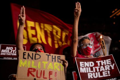Filipino activists raise three-finger salutes during a protest and noise barrage against the Myanmar military coup, in Quezon City, Metro Manila, Philippines, February 11, 2021. REUTERS/Eloisa Lopez