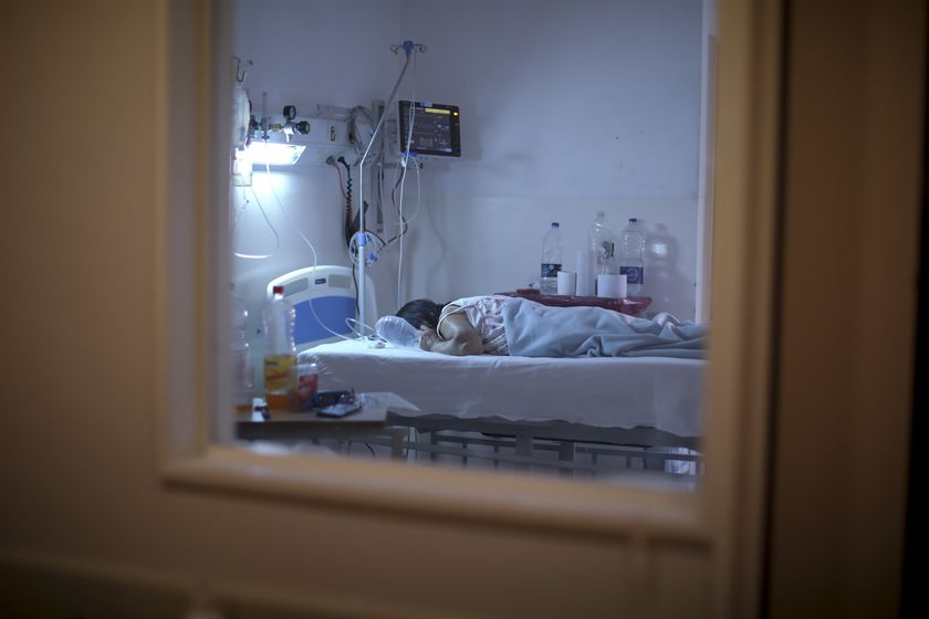 A patient with COVID-19 lies on a bed at the Eurnekian Ezeiza Hospital in Buenos Aires, Argentina, Thursday, Aug. 13, 2020. At a time when the number of deaths due to COVID-19 has increased in Argentina, some hospitals are now allowing persons, fully decked out in protective gear, to accompany their dying relatives. (AP Photo/Natacha Pisarenko)