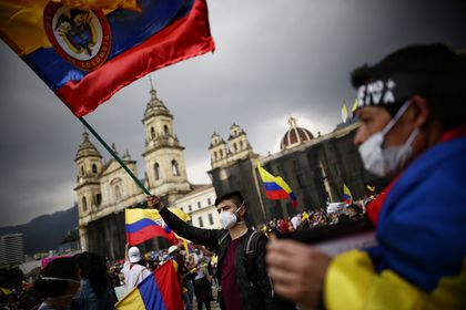 05 May 2021, Colombia, Bogota: Protesters take part in a demonstration  against President Duque's government and police violence. Photo: Sergio Acero/colprensa/dpa