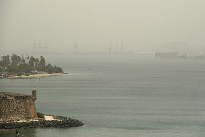 The Bay of San Juan  as a sand storm from the region of the Sahara Desert sweeps over San Juan