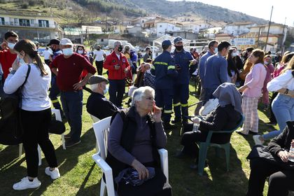 Local residents gather at a soccer field after an earthquake in Mesochori village, central Greece, Wednesday, March 3, 2021. An earthquake with a preliminary magnitude of up to 6.3 struck central Greece on Wednesday and was felt as far away as the capitals of neighboring Albania, North Macedonia, Kosovo and Montenegro. (AP Photo/Vaggelis Kousioras)