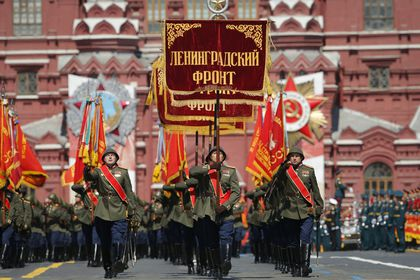 Russian soldiers march toward Red Square during the Victory Day military parade marking the 75th anniversary of the Nazi defeat in Red Square in Moscow, Russia, Wednesday, June 24, 2020. The Victory Day parade normally is held on May 9, the nation's most important secular holiday, but this year it was postponed due to the coronavirus pandemic. (AP Photo/Alexander Zemlianichenko)