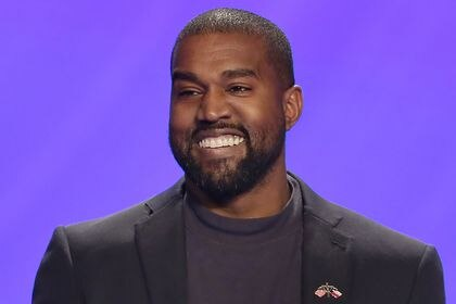 FILE - In this Nov. 17, 2019, file photo, Kanye West appears on stage during a service at Lakewood Church in Houston. The Arizona Supreme Court is considering an appeal by West of a decision on Thursday, Sept. 3, 2020, that barred him from appearing on the state's Nov. 3 ballot as an independent presidential candidate. Ballot printing deadlines are fast approaching in the state. (AP Photo/Michael Wyke, File)