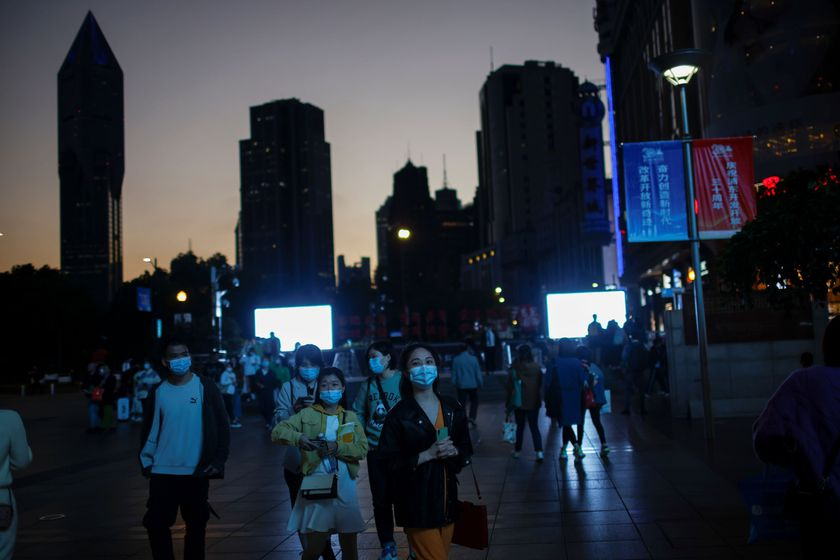 People wearing face masks walk on a street, amid the coronavirus disease (COVID-19) pandemic, in Shanghai, China November 13, 2020. REUTERS/Aly Song