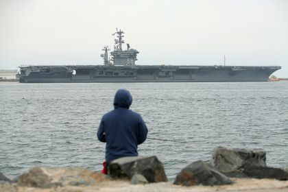 FILE PHOTO: Aircraft carrier USS Nimitz departs San Diego with Carrier Strike Group 11 and some 7,500 sailors and airmen for a 6 month deployment in the Western Pacific