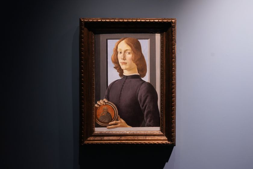"Sandro Botticelli's 15th-century painting called ""Young Man Holding a Roundel"" is displayed at Sotheby's on Sept. 23, 2020, in New York. The painting will go on auction next year and art watchers will be seeing if it fetches more than its eye-watering $80 million estimate, despite the pandemic. Botticelli's 15th-century portrait of a nobleman in ""Young Man Holding a Roundel"" is the highlight of Sotheby's Masters Week sale series in New York in January. (AP Photo/Seth Wenig)"