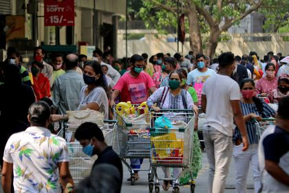 People push trolleys loaded with grocery items as others wait to enter a supermarket, amidst the spread of the coronavirus disease (COVID-19) in Mumbai, India, April 14, 2021. REUTERS/Niharika Kulkarni