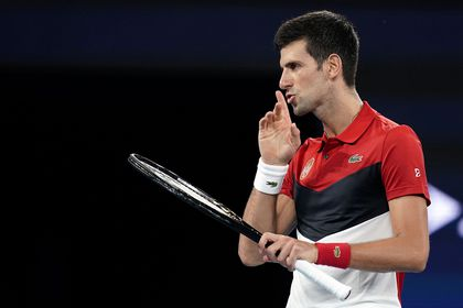 Novak Djokovic of Serbia gestures during his singles match against Kevin Anderson of South Africa on day 2 of the ATP Cup tennis tournament at Pat Rafter Arena in Brisbane