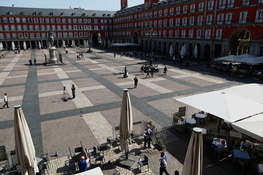 Workers remove the terrace of a restaurant due to the coronavirus outbreak at Plaza Mayor in Madrid