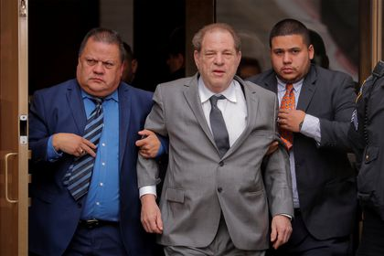 FILE PHOTO: Film producer Harvey Weinstein exits following a hearing in his sexual assault case at New York State Supreme Court in New York