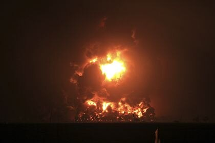 Night sky glows from a fire that razes through Pertamina Balongan Refinery in Indramayu, West Java, Indonesia, early Monday, March 29, 2021. Hundreds of people were evacuated from a nearby village after the massive fire broke out at the refinery. (AP Photo)