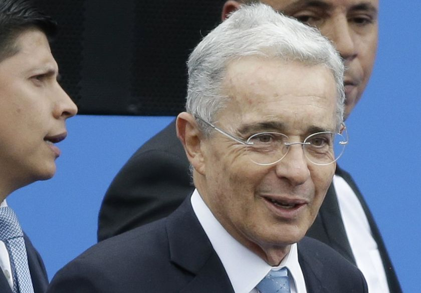 FILE - In this Aug. 7, 2018 file photo, Colombia's former President and Senator Alvaro Uribe arrives to the inauguration ceremony for Colombia's new president Ivan Duque in Bogota, Colombia.   Uribe has been ordered freed from house arrest while he is investigated for possible witness tampering. A judge ordered Uribe's release Saturday, Oct. 10, 2020,  in a case that has divided the South American nation and exposed lingering tensions over Colombia's peace accord for ending a half-century conflict with leftist guerrillas.  (AP Photo/Fernando Vergara, File)