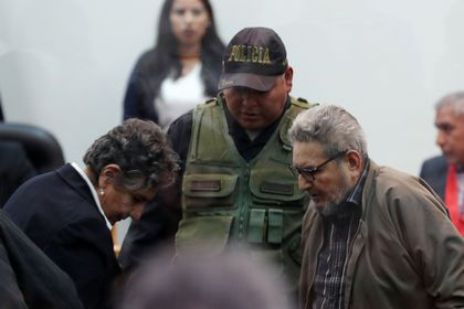 FILE PHOTO: Shining Path founder Abimael Guzman and his wife and second leader Elena Iparraguirre attend a trial during sentence of a 1992 Shining Path car bomb case in Miraflores, at a high security naval prison in Callao, Peru September 11, 2018. Picture taken through a window. REUTERS/Mariana Bazo/File Photo