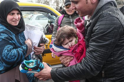 Refugees and migrants gather at the Turkish-Greek land border