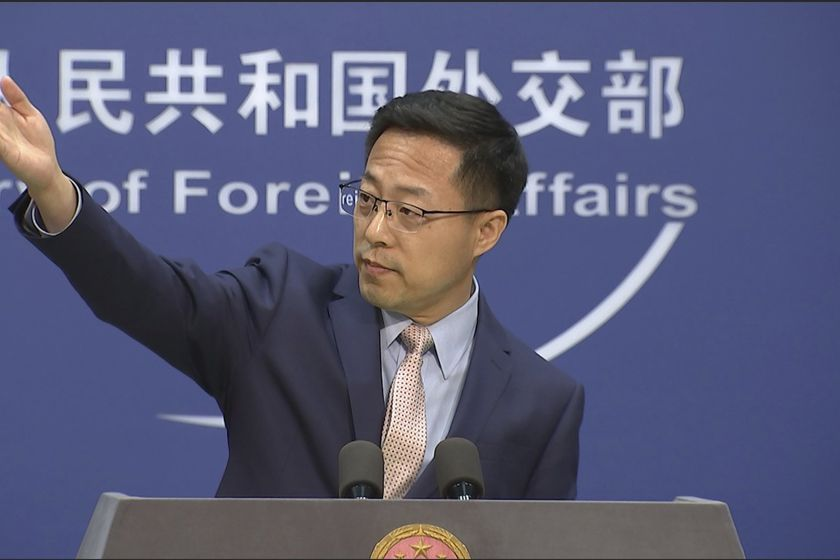 "Chinese foreign ministry spokesperson Zhao Lijian gestures during a press briefing in Beijing on Monday, Nov. 23, 2020. China on Monday lashed out at Washington over its withdrawal from the ""Open Skies Treaty"" with Russia, saying the move undermined military trust and transparency and imperiled future attempts at arms control. (AP Photo/Liu Zheng)"