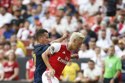[Mesut Ozil (10) battle for the ball during the first half of a match in the International Champions Cup]