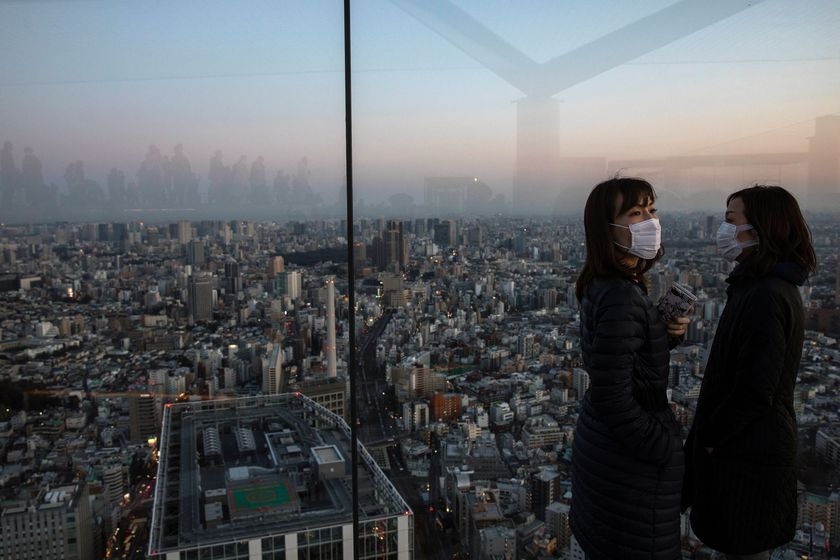 People wearing protective masks are seen at the Shibuya sky observation deck, following an outbreak of the novel coronavirus in Tokyo