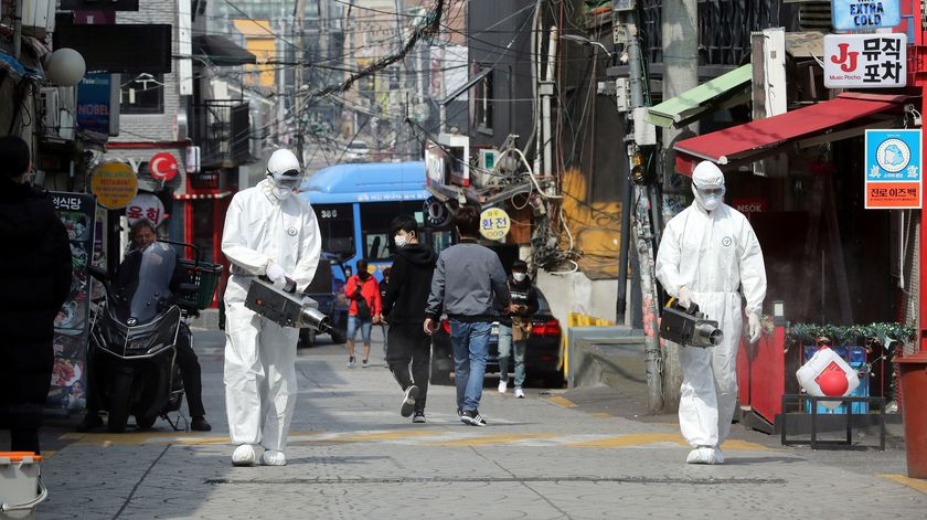 Quarantine workers spray disinfectants at night spots of Itaewon neighborhood, following the coronavirus disease (COVID-19) outbreak, in Seoul