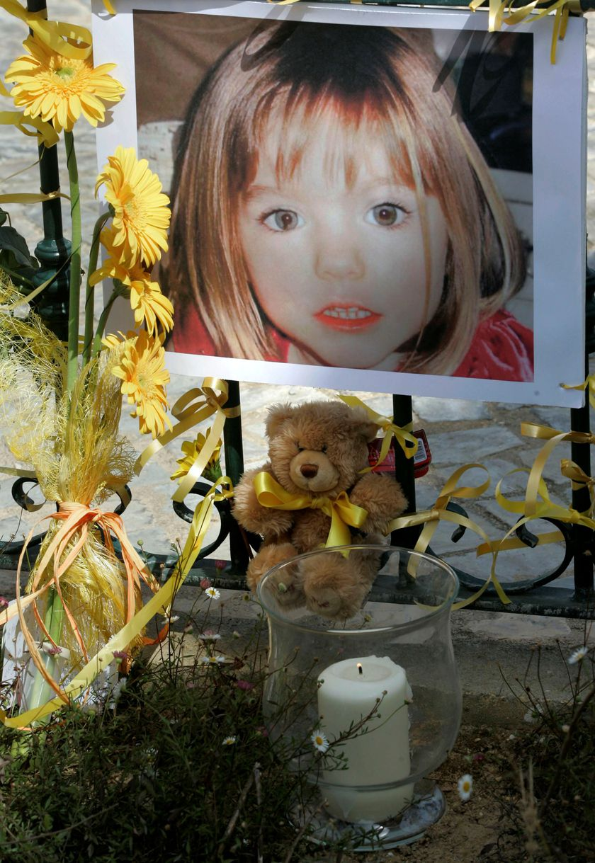 FILE PHOTO: Poster of the missing three-year-old British girl Madeleine McCann is surrounded by flowers and hope-bows in the Portuguese beach resort of Lagos