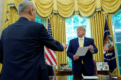 FILE PHOTO: U.S. President Donald Trump meets with China's Vice Premier Liu at the White House in Washington
