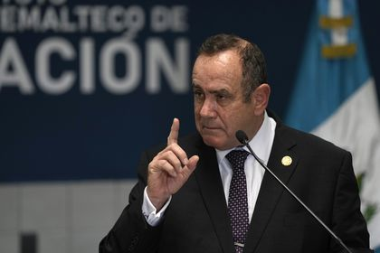 Guatemalan President Alejandro Giammattei speaks at a new facility to receive deported Guatemalans at La Aurora Air Force base during its inauguration ceremony also attended by U.S. Secretary of Homeland Security Alejandro Mayorkas in Guatemala City, Wednesday, July 7, 2021. (AP Photo/Moises Castillo)
