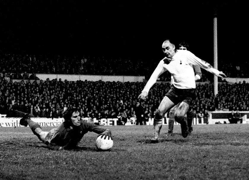 FILE - In this Jan. 6, 1972 file photo, Liverpool goalkeeper Ray Clemence dives at the feet of Tottenham Hotspur's Alan Gilzean. Ray Clemence, the former Liverpool, Tottenham and England goalkeeper, has died. He was 72. The Football Association confirmed the news Sunday, Nov. 15, 2020 without giving a cause of death. (PA via AP, File)