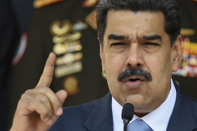 FILE - In this March 12, 2020 file photo, Venezuelan President Nicolas Maduro gives a press conference at Miraflores presidential palace in Caracas, Venezuela. Independent experts commissioned by the U.N.'s top human rights body have issued a scathing, in-depth report finding the government of Venezuelan President Nicolas Maduro responsible for crimes against humanity. The report commissioned last year by the 47-member-state Human Rights Council said the alleged crimes include extrajudicial executions, enforced disappearances, arbitrary detentions and torture. The findings issued Wednesday, Sept. 16, 2020 were based on nearly 3,000 cases, interviews and other evidence. (AP Photo/Matias Delacroix, File)