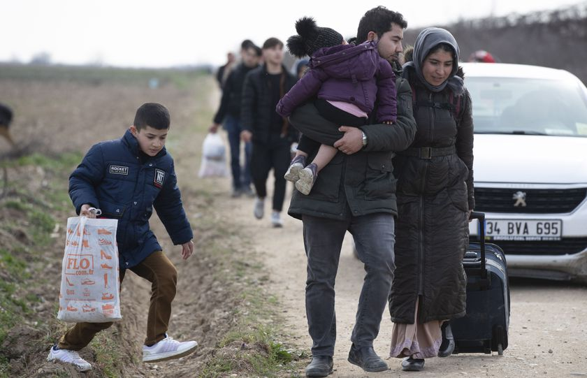 Refugees try to reach Europe from Erdine, Syria