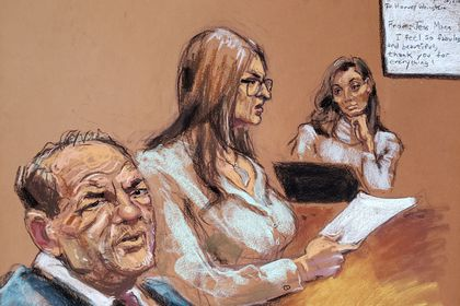 Film producer Harvey Weinstein watches as witness Jessica Mann is questioned by Donna Rotunno in front of Judge James Burke during Weinstein's sexual assault trial