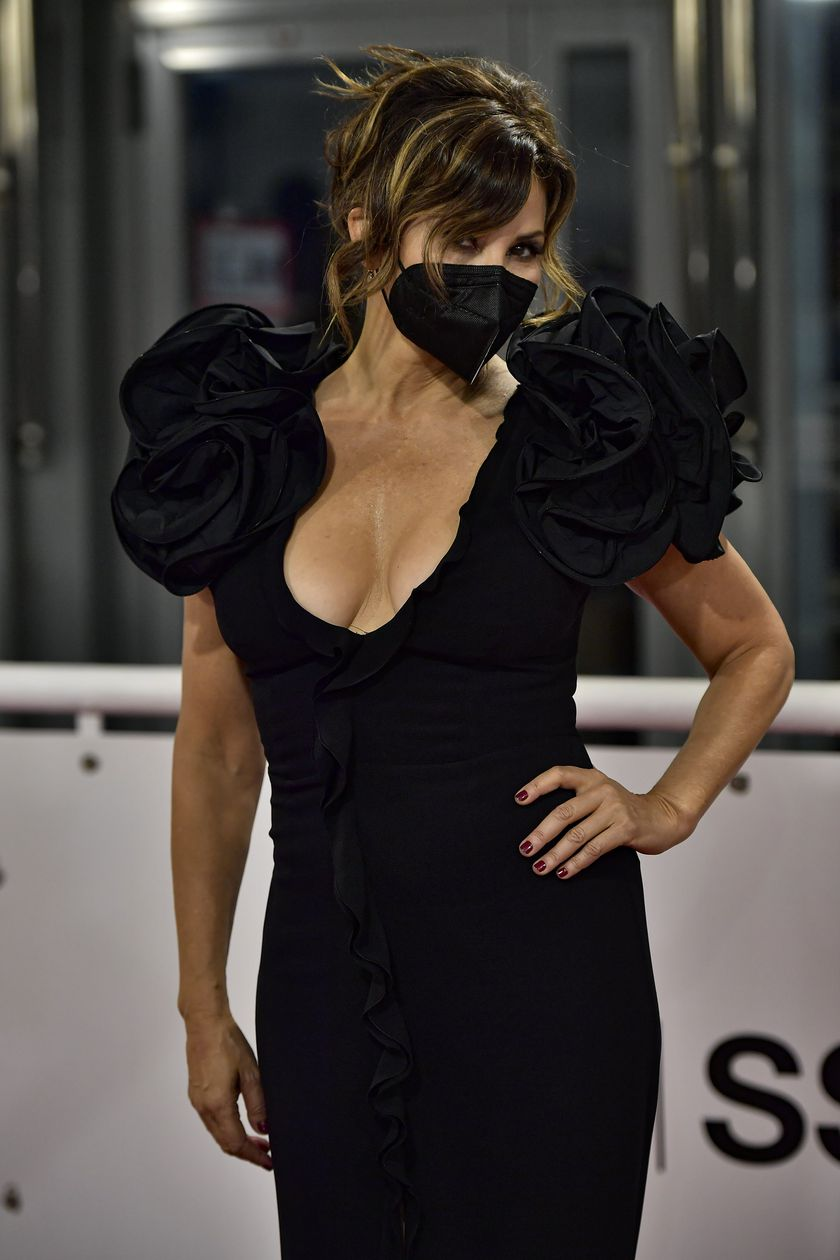 US actress Gina Gershon poses along an empty red carpet during the opening ceremony at the 68th San Sebastian Film Festival, in San Sebastian, northern Spain, Friday, Sept. 18, 2020. (AP Photo/Alvaro Barrientos)