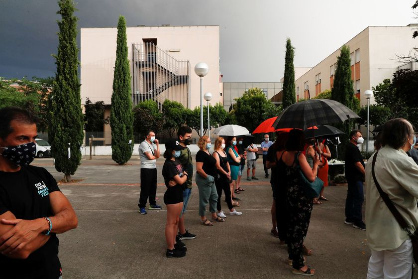 Family members and friends take part in a tribute for people who died from the coronavirus disease (COVID-19), at a nursing home in Leganes, near Madrid