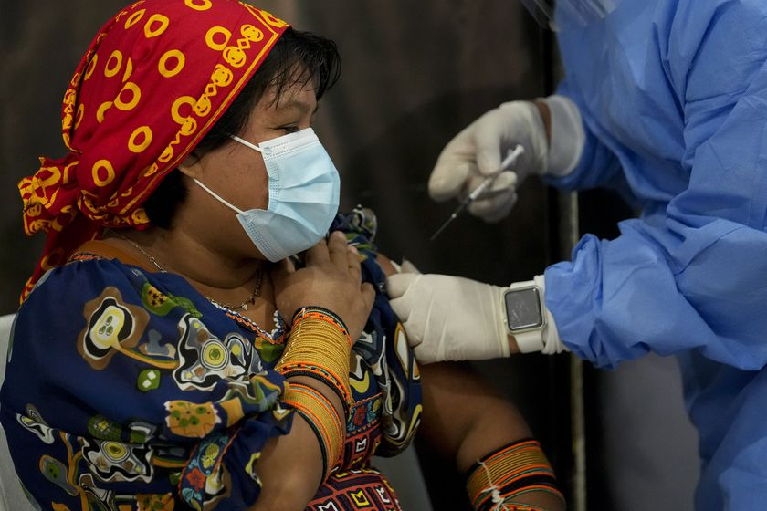 A healthcare worker gives a Guna Indigenous woman a shot of the AstraZeneca vaccine for COVID-19 at the Mega Mall on the outskirts of Panama City, Wednesday, June 9, 2021. On Wednesday, Panama began vaccinating women age 30 and older. (AP Photo/Arnulfo Franco)