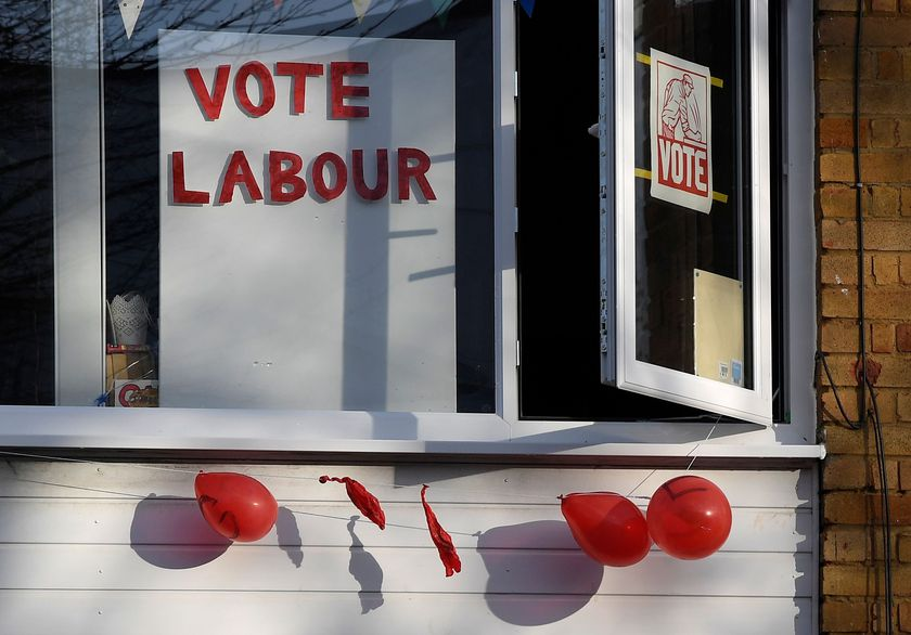 Political election campaign messages and burst balloons are seen at a house in the same street where Labour party leader Jeremy Corbyn lives, London, Britain
