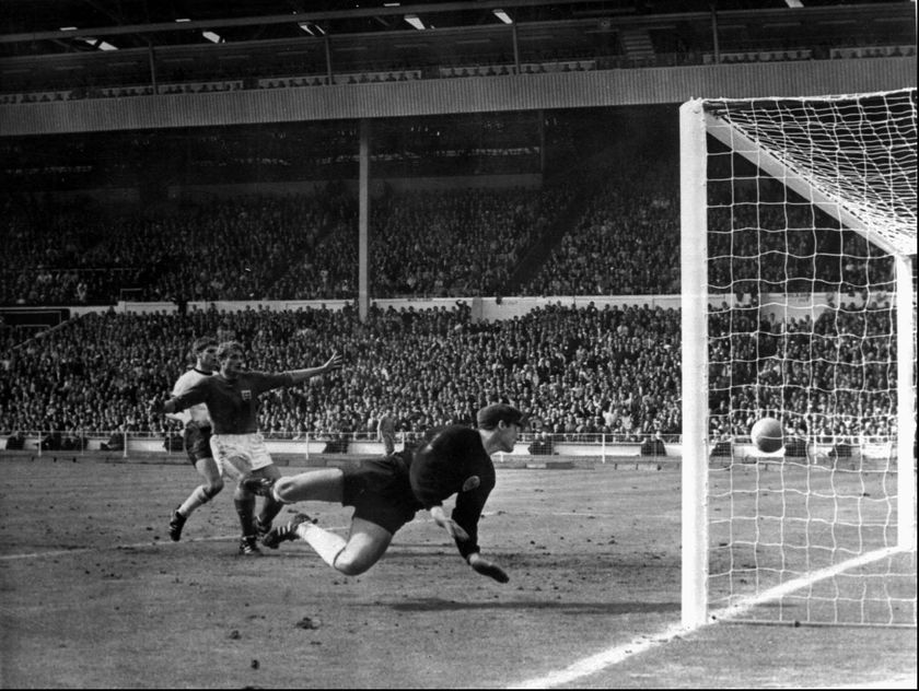 FILE - In this July 30, 1966 file photo, a shot from Geoff Hurst bounces down from the West Germany crossbar during the World Cup final at London's Wembley Stadium. The linesman gave it as a goal and England went to to win 4-2. England won its only World Cup title by beating West Germany in London in a match that produced an enduring moment of controversy that is still the subject of debate. In extra time with the scored even at 2-2, Alan Ball crossed to England teammate Geoff Hurst, who turned and shot. The ball thumped down from the underside of the West German crossbar and Roger Hunt raised his arms to proclaim the ball bounced over the goal line. (AP Photo/File)