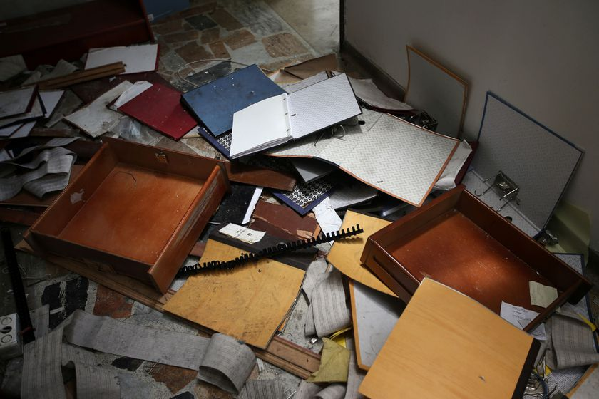 Debris and destroyed furniture are seen inside the Venezuelan consulate, after it's been looted for months, in Bogota