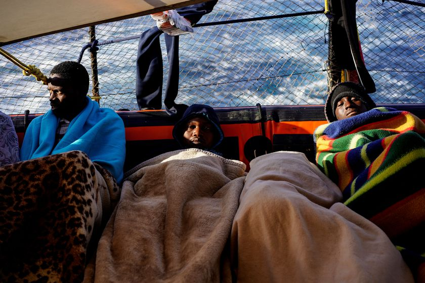 Migrants rest on board a NGO Proactiva Open Arms rescue boat in central Mediterranean Sea sailing to the Italian port of Taranto