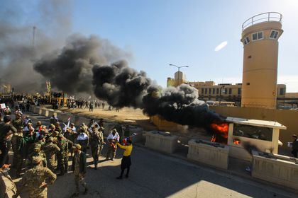 Iraqi mourners storm US embassy in Baghdad after deadly strikes