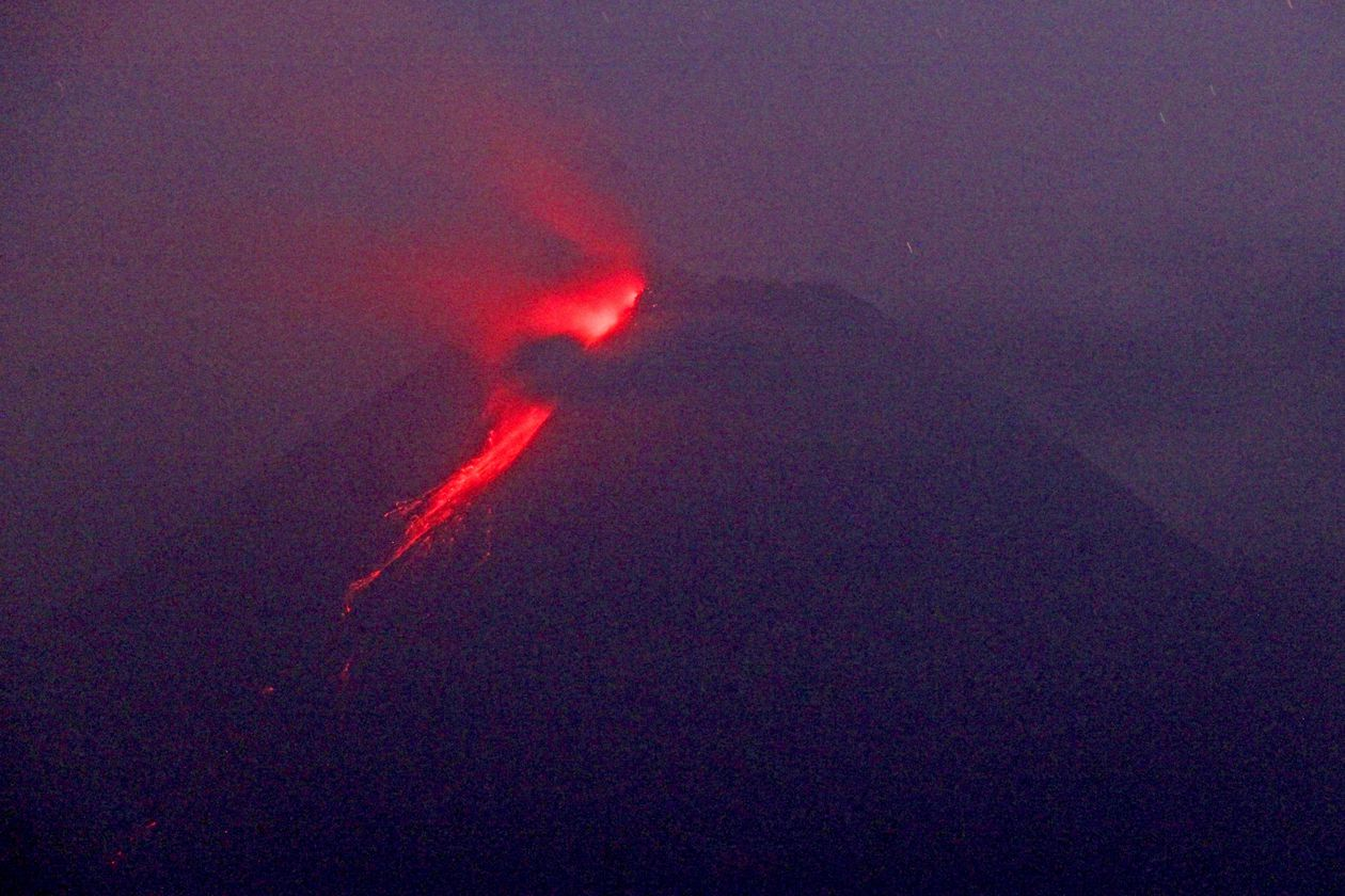 Indonesian volcano continues to eject lava and ash clouds