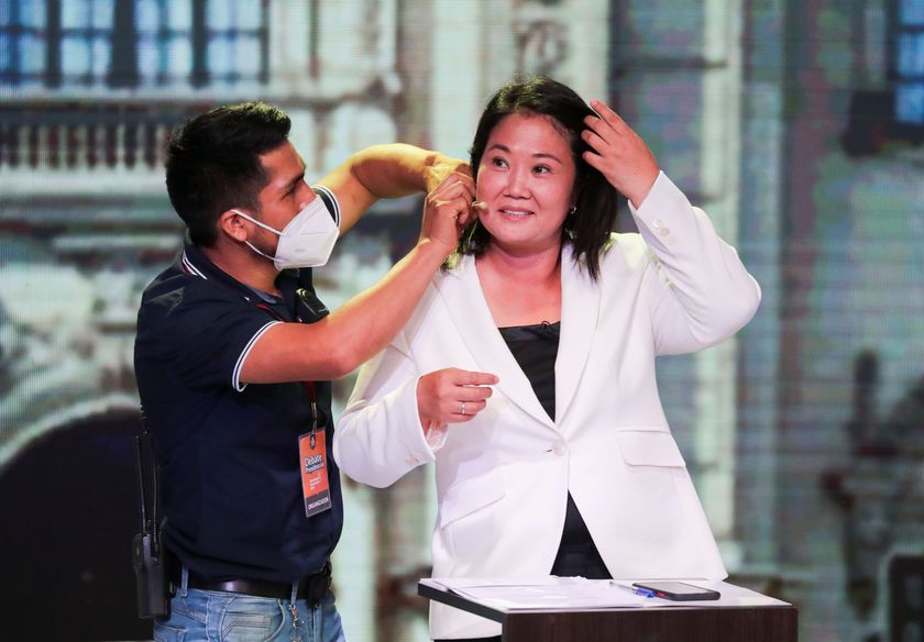 Peru's presidential candidate Keiko Fujimori of the Fuerza Popular party has her microphone adjusted as she prepares to participate in a presidential candidates debate, in Lima, Peru March 29, 2021. REUTERS/Sebastian Castaneda/Pool