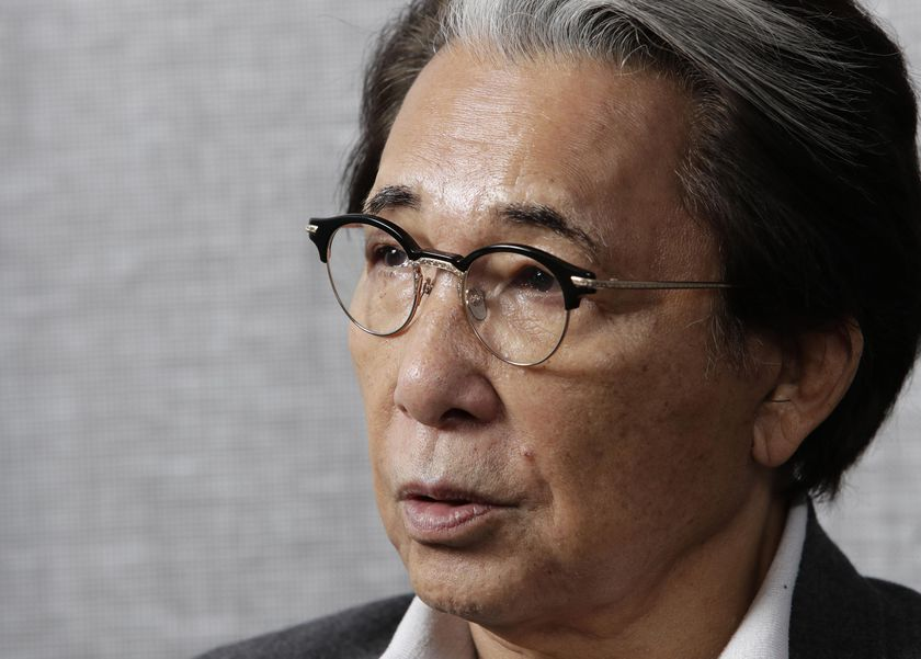 Fashion designer Kenzo Takada speaks in an interview in Tokyo on Oct. 5, 2019. Takada's family said in a statement to French media Sunday, Oct. 4, 2020 that Takada died from complications from COVID-19 in a hospital in Neuilly-sur-Seine, near Paris. He was 81. (Kyodo News via AP)