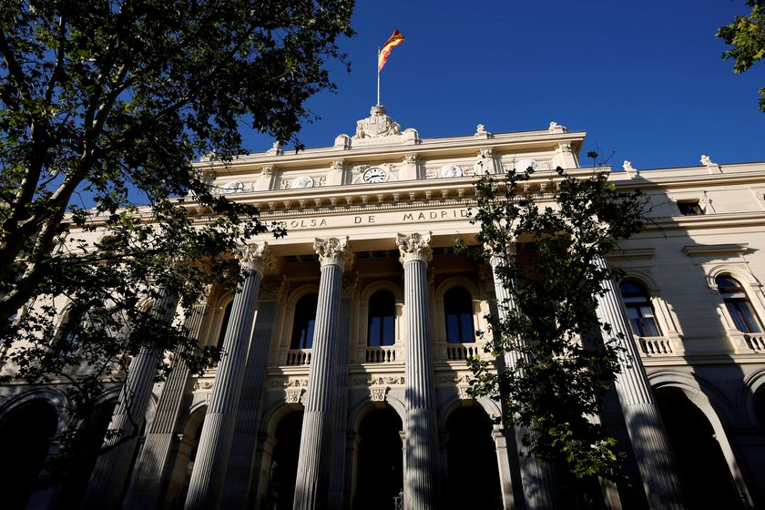 FILE PHOTO: A Spanish flag flutters above the Madrid Bourse